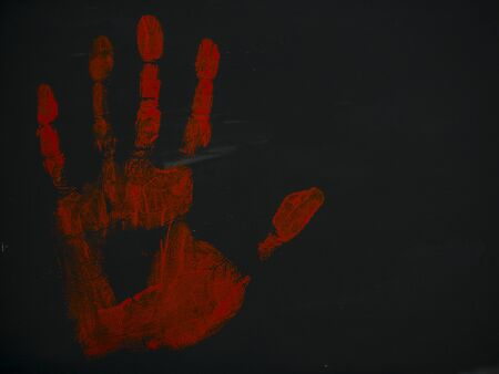 gouache drawing bloody handprint on a black background 스톡 콘텐츠