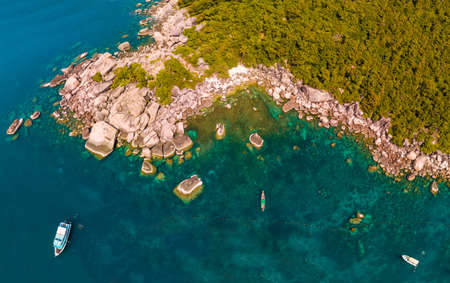 aerial drone shooting of the coast with rocks and moored boats Stock Photo