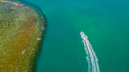 aerial photography moored boat in the bay of the thai lagoon