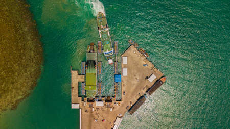 ferry moored in commercial dock aerial photography