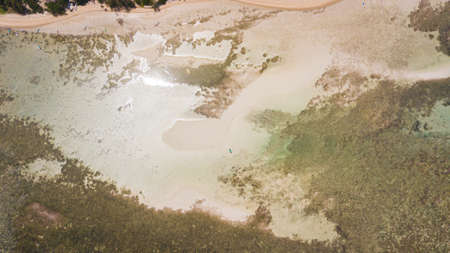 aerial photography of the Indian Ocean coastline. Burmese gather oysters in shallow waters.