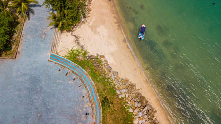 aerial drone photography of the ocean coast with gazebo and fishing boats