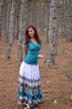 nightfall: The young brown-eyed girl the brown-haired woman in a dress in the coniferous wood