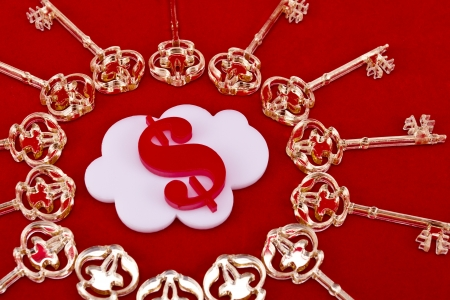 Red dollar sign shape made of  lie inside of a white cloud shape with a golden skeleton keys around on a red background  photo