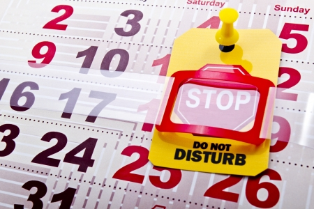 do not disturb: Do not disturb at weekend concept shot  Do not disturb yellow label tag with a stop road sign on a paper calendar background