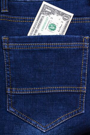 American one dollar banknotes in pocket of blue jeans. Close-up. 免版税图像