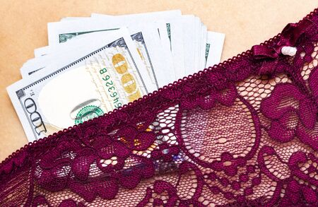 Lingerie with money concept. Close up view Stock Photo