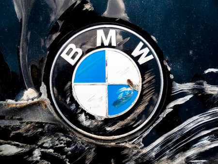 Odessa, Ukraine - April 21, 2021: Macro Shot of a Bmw Motor Company Badge on the front from a black car after the road accident. BMW is a German automobile, motorcycle and engine manufacturing company.