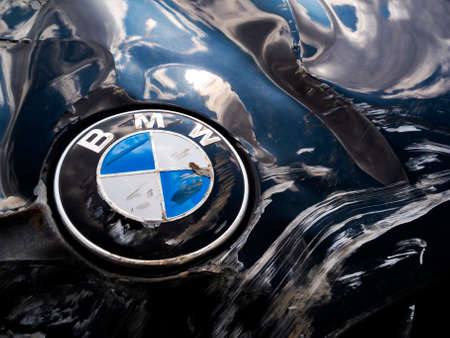 Odessa, Ukraine - April 21, 2021: Macro Shot of a Bmw Motor Company Badge from black car after the road accident.