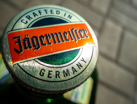 Odessa, Ukraine - April 21, 2021: Jagermeister cork macro closeup. Top view, focus on the cork. Jagermeister made with 56 herbs and spices. It is manufactured by Mast-Jagermeister SE, Germany.