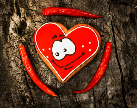 Chile.Red hot peppers and sweet gingerbread. Love , passion.Toning and vignetting Stock Photo