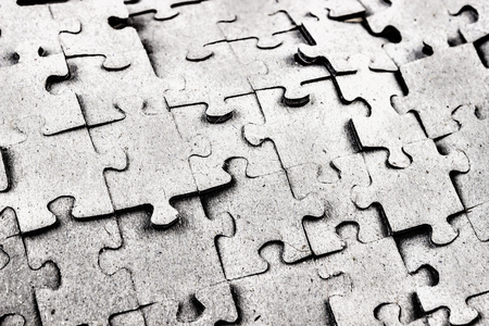 Abstract background. Scattered and stacked puzzles of the same c