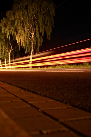 street in the night with driving cars Stock Photo