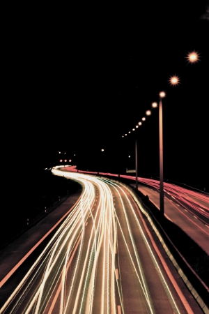 dynamically: street in the night with driving cars Stock Photo