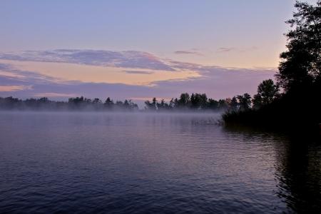 a lake on a foggy autumn morning