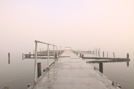 a lake on a foggy october morning