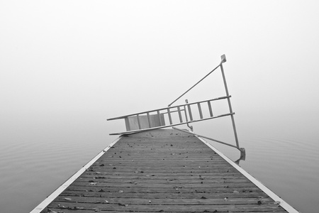 a lake on a foggy october morning photo