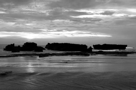 a beach of the ocean on a hot summer day