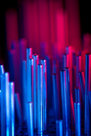 a group of metal rods meets colored light Stock Photo
