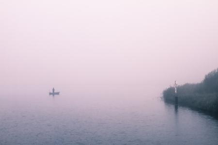 a foggy landscape on a november morning photo