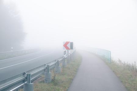 A street on a foggy October day Standard-Bild