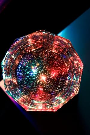 Una copa en la noche de colores Foto de archivo