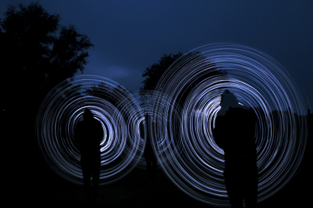 darkly: people make a light show in the night