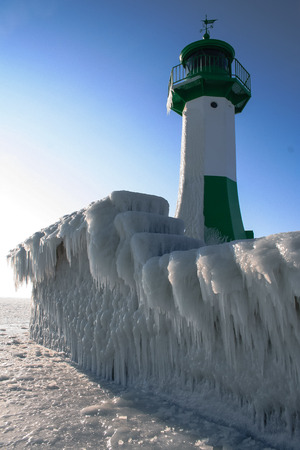 A lighthouse in the winter sun