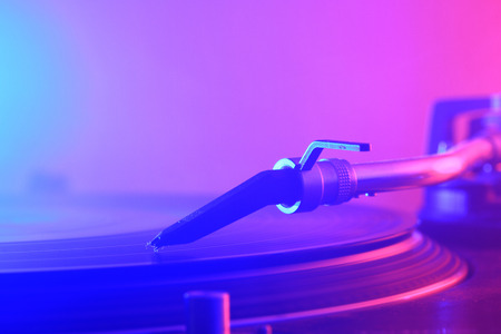a turntable in the foggy and colorful night