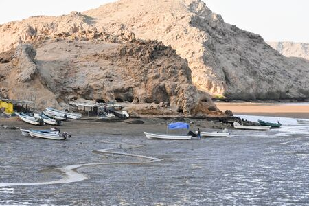 All the fishing boats of the village are laying on the soil waiting the flow