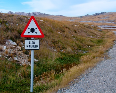 port stanley: A warning sign marks an area of explosives left over from the Falkland Island War.
