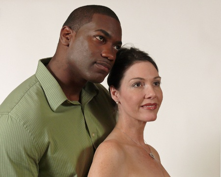 Portrait of African American male and Caucasian Female against a white background.