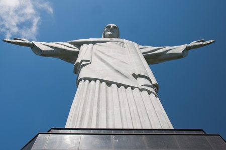 The statue sits atop Corcovado mountain and overlooks the city.