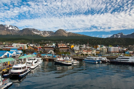 Boats fill the harbor at Ushuaia, the southernmost city in the world. Фото со стока