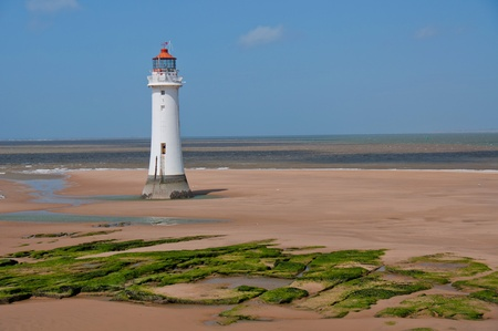 New Brighton Lighthouse. UK. Built in the 1800s, the lighthouse overlooks the River Mersey on a summer day
