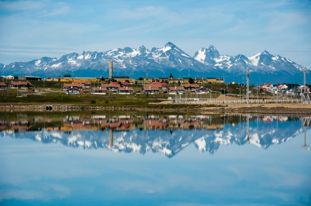 Ushuaia Reflections. Snow covered mountains are reflected in the ocean along Ushuaia's coastline