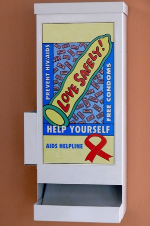 Condom dispenser in at the border of Zimbabwe and Botswana, Africa.