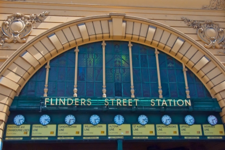 A row of clocks under the entrance arch display the departure times of the trains