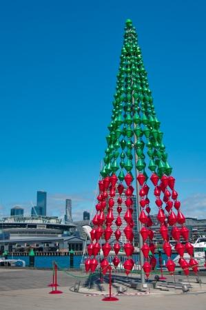 A Christmas tree overlooks the Etihad Stadium in the Victoria Harbour Editorial