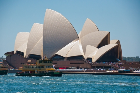A ferry boat transports tourist to and from the iconic building