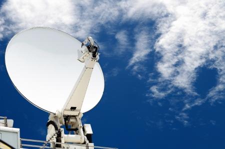 satellite dish antennas with blue sky photo