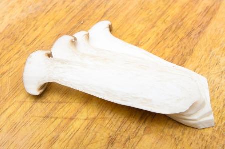 Eringii Mushrooms on the chopping block photo
