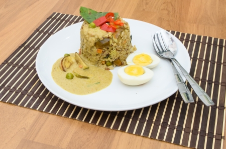 Fried rice green curry with pork and boil egg photo