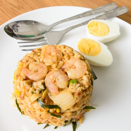 Khow Pat Tom Yum Koong  - Stir fried spicy rice with herbs and prawns serving with boiled egg ,thai food photo