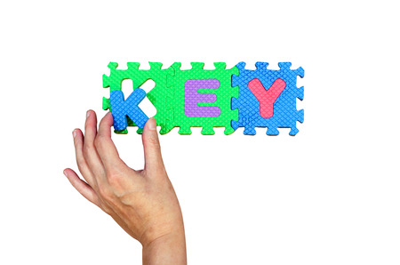 Women hold K alphabet put to its hole for successfully key word photo