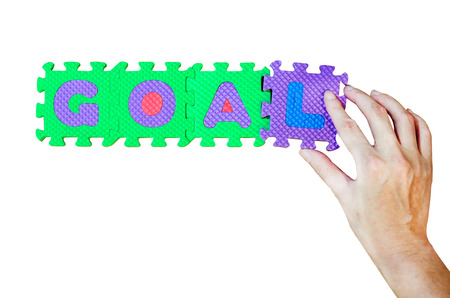 Women hold L alphabet add to GOAL word photo