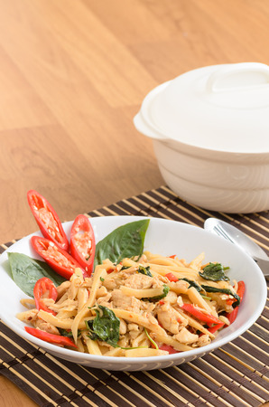stir fried: Stir fried spicy chicken with bamboo shoots in white dish