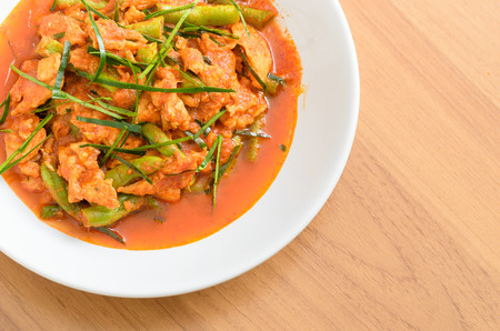 long bean: Fried stir pork with yard long bean and red curry paste in white dish