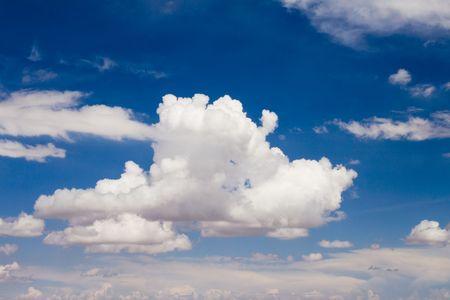 Big fluffy clouds in a brilliant blue sky