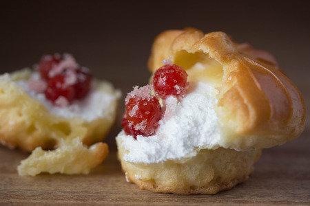 Choux Cream Stuffed With Custard Cream with berries Archivio Fotografico